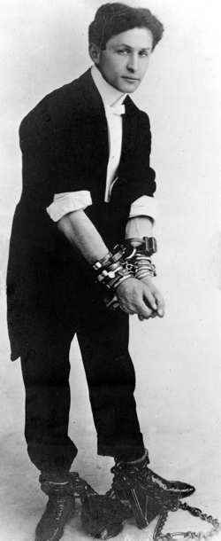 Harry Houdini in handcuffs and shackles
